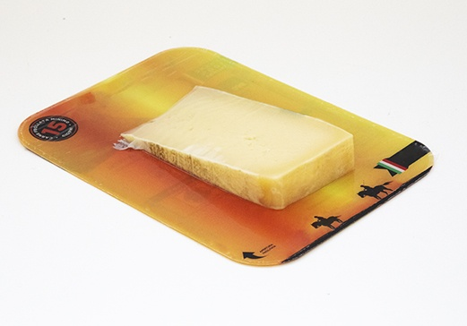 cheese packaging on plastic board
